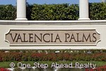 the impressive entrance to Valencia Palms of Delray Beach, FL greets you and your guests