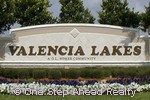 the Valencia Lakes active adult community in Boynton Beach, Florida greets you.